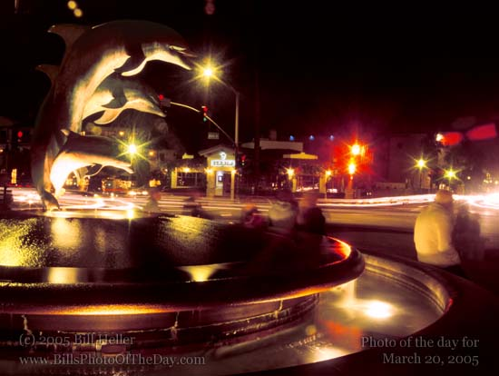 Evening shot of the Dolphin Fountain at Stearns Whaf