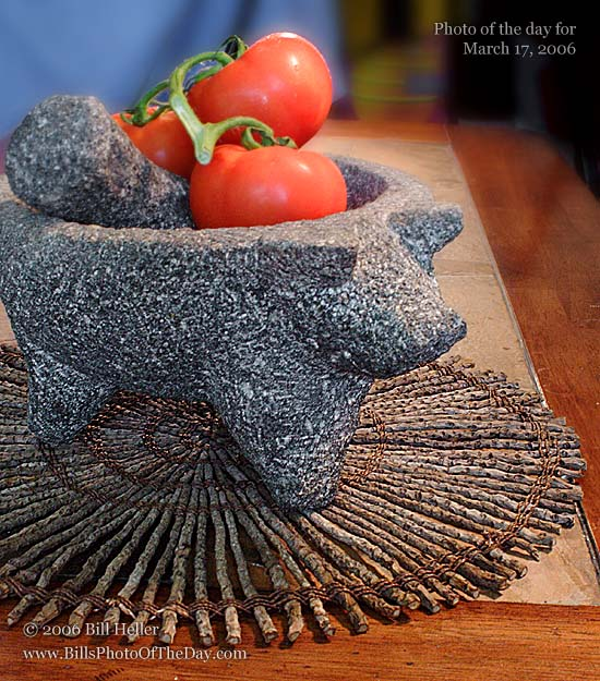 Pig shaped Mortar & Pestle and Tomatos on the vine